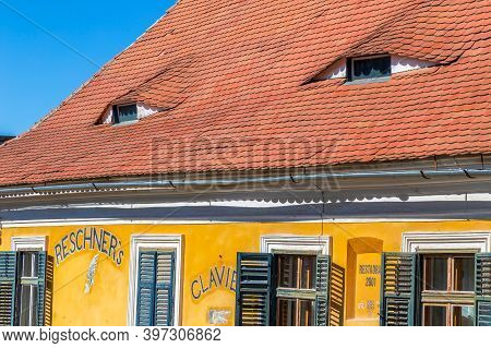 Sibiu, Transylvania, Romania - July 8, 2020: Roofs With Windows Like Eyes, Typical Architecture Of S