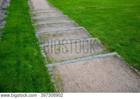 Park Stairs Made Of Beige Gravel Material Bordered By Granite Cubes Follow The Gravel Path With A Lo