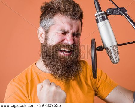 Bearded Man Scream In Microphone. Karaoke. Man Singing With A Microphone. Singing In Studio. Microph