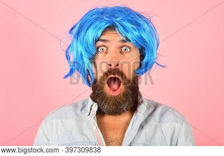 Surprised Man In Color Wig. Surprised Bearded Man Looking At Camera. Portrait Of Surprised Man. Isol