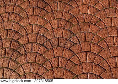Old Orange Pavement. Geometric Tile Ornament, Pavement Pattern. Paved Moss-covered Road. Decorative