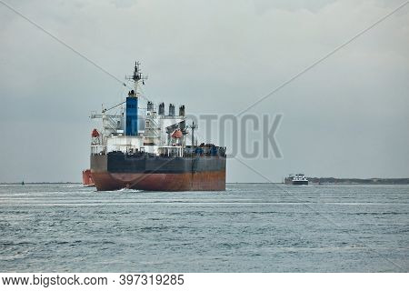 Large crude oil tanker ship leaving the port of Rotterdam to the North Sea