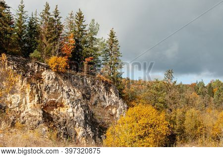 A Forest In Autumn Leaf Colors In The Rocky Landscape Of Swabian Alb With A Cliff Of Jurassic Limest