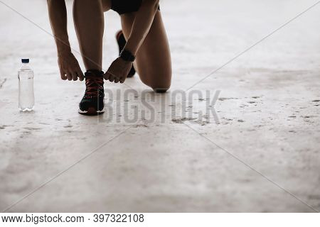 Health Care And Exercise In Middle Age. Muscular Lady In Sports Uniform And Fitness Tracker Ties Sho
