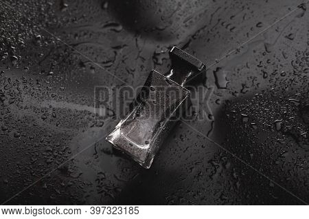 Black Bottle Perfume On A Black Background