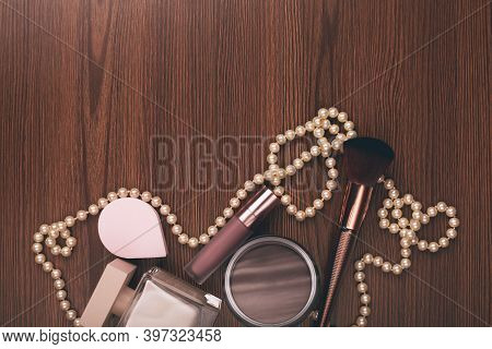 Women's Accessories. Perfume, Cream And Makeup Brush On Wooden Background