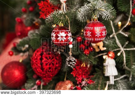 Christmas Tree Decor In Red Style And Bokeh. Christmas Tree, Christmas Decorations, Toys Close-up An