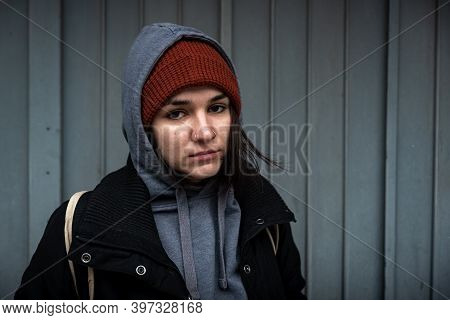 Very Young Hungry And Scared Homeless Teenager Girl Standing Alone On The Street In The Cold Winter