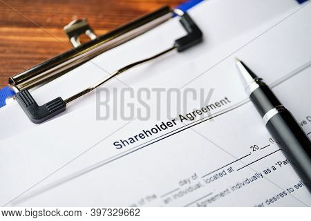 Legal Document Shareholder Agreement On Paper With Pen.
