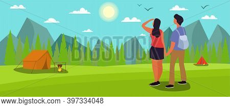 Couple Of Man And Woman Hiking Or Backpacking In Forest Or Woods In Mountains. Young Tourists Or Bac
