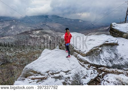 Drone View On A Athlete Runner Standing On A Rock Admiring Beautiful Mountain Views.