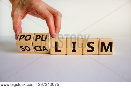 Populism Or Socialism. Hand Turns Cubes And Changes Word 'globalism' To 'populism'. Beautiful White