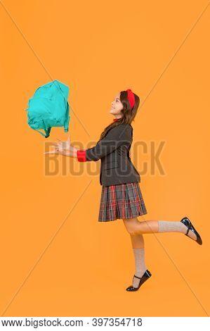 Stay Organized This School Year. Happy Kid Throw Bag Up Yellow Background. Schoolbag. School Bag. Cl
