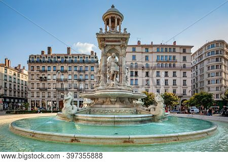 17 sep 2020, Lyon, France: Fountain at Jacobin square with relaxing people and tourists