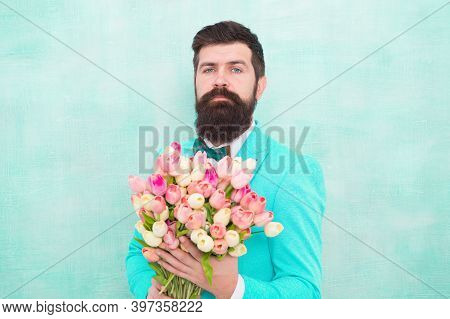 Flowers For Her. Man Bearded Suit Bow Tie Hold Tulips Bouquet. Gentleman Making Romantic Surprise Fo