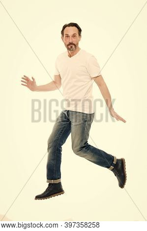 Maintaining Active Lifestyle. Active Man Jump Isolated On White. Middle Age Adult. Mature Person In