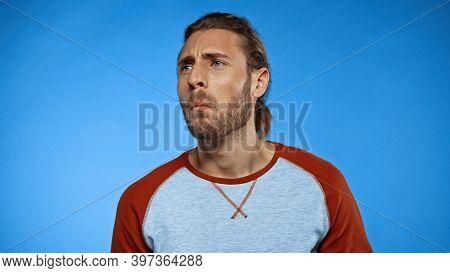Bearded Man Feeling Unpleasant Smell On Blue