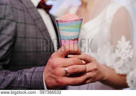 Wedding Ceremony, Mixing Sands Is A New Family. Close Up View Hands Of Bride And Groom Doing Sand Ce