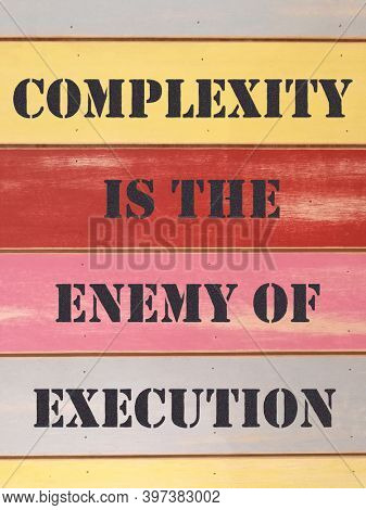 Quote on complexity and execution, written on colorful plank