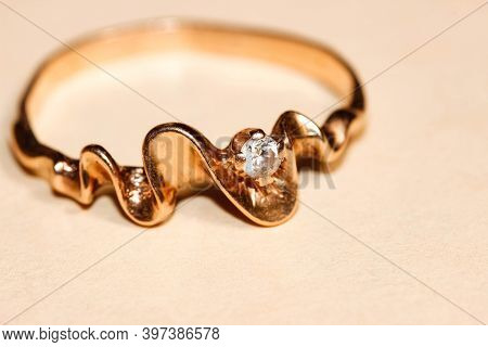 Old Gold Ring With Cubic Zirconia Close-up On A Light Background. Macro, Selective Focus.