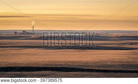 sunrise over prairie and foothills of northern Colorado near Fort Collins with a distant power plant