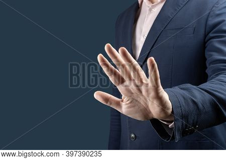 Businessman With Stop Gesture. Businessman In Suit Making Stop Gesture, Holding His Palm Outward Ove