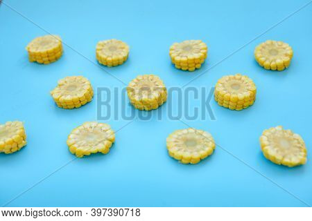 Sweetcorn Against Blue Background. Flat Lay Composition With Tasty Sweet Corn Cobs On Color Backgrou