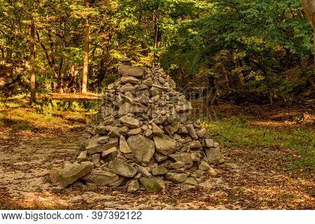 Man Made Stack Of Stones In Forest Glade In Wilderness Park.