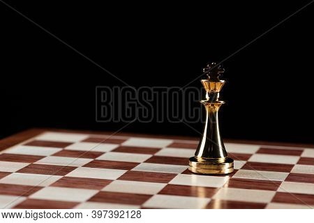 Golden King Chess Figure Standing On Chessboard. Intellectual And Tactic Game. Strategy Planning, Le