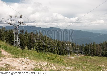 Older Double Chairlifts At Seymour Mountain With Scenic View In The Background During The Summer Sea