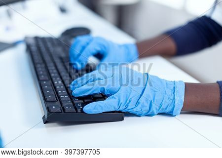 Close Up Of African Researcher Holding Hands On Computer Keyboard Black Healthcare Scientist In Bioc