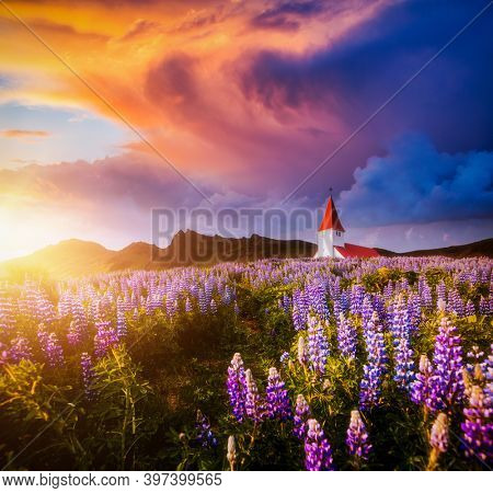 Perfect view of Vikurkirkja christian church at sunset. Location place Vik i Myrdal village, Iceland, Europe. Photo of popular tourist attraction. Picturesque wallpaper. Discover the beauty of earth.