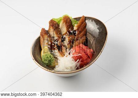 Sushi Sashimi Unagi. Eel Slices In Teriyaki Sauce With Daikon Radish, Ginger, Wasabi, Lettuce And Le