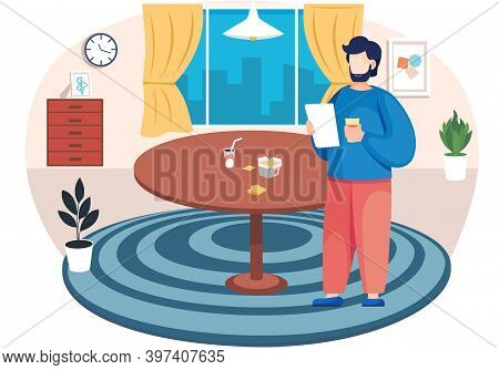 Bearded Man With A Paper Sheet Is Standing In A Room With Big Round Table With Fast Food Box And Dri