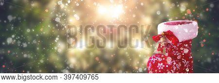 Christmas Concept: Christmas Shoes On Abstract Christmas Lights Background