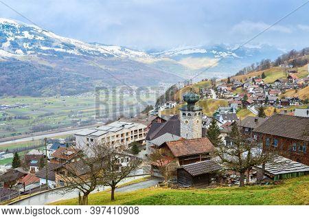 View of Triesenberg in the rain in late autumn, Liechtenstein. Triesenberg is a municipality in Liechtenstein.