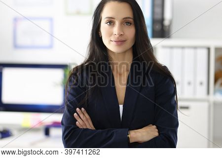 Portrait Of Young Brunette Woman In Business Suit In Office. Implementation Of Women In Business Con