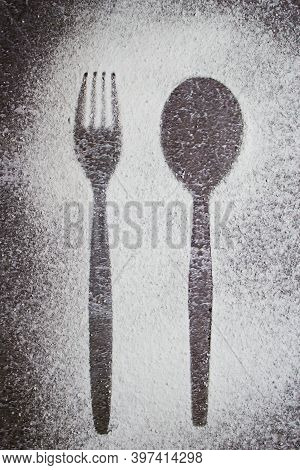 Too Much Sugar Is Harmful. Outline Of A Fork And Spoon In Sprinkled White Powdered Sugar.