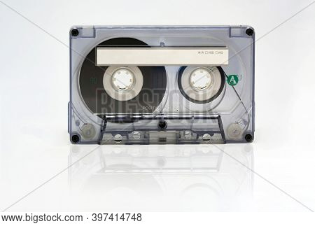 Transparent 90 Minute Audio Cassette With Blank Adhesive Label. Side A Of The Cassette. Magnetic Tap