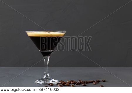 Espresso Martini Cocktail Garnished With Coffee Beans On Table. Martini Glass With Brown Coffee Bean