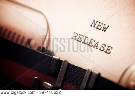 New release phrase written with a typewriter.