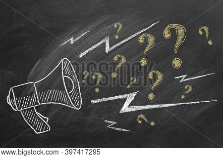 Megaphone With  Question Marks Hand Drawn In Chalk On A Blackboard. Ask For Help. Faq Concept.  Aski