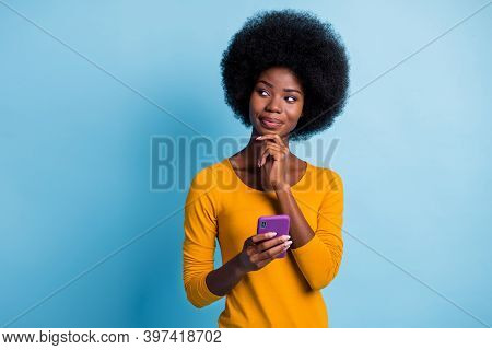 Photo Portrait Of Thoughtful Curious Black Skinned Girl Looking At Blank Space Touching Chin Isolate