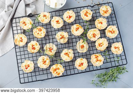 Mini Quiche Muffins With Feta Cheese, Fried Onion, Thyme And Red Bell Pepper, On A Cooling Rack, Hor