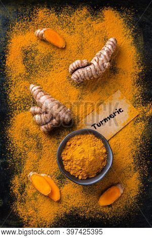 Food And Drink, Diet Nutrition, Health Care Concept. Raw Organic Orange Turmeric Root And Powder, Cu