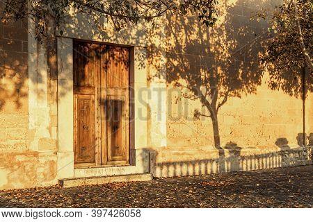 Close-up Of The Closed Entrance Of The Oratori De La Santa Creu. Christian Religious Building Locate