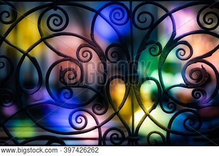 Forged metal grille with bokeh effect.