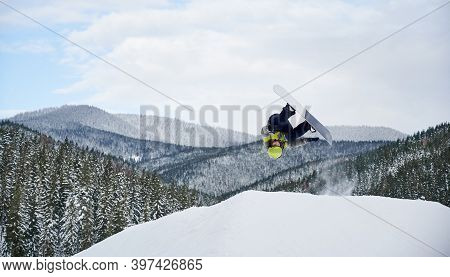 Horizontal Snapshot Of Spectacular Freeriding Fly By Snowboarder. Cool Snowboard Jump On Slope Again