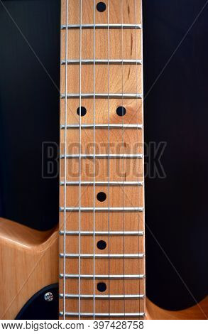 Electric Guitar Background. Maple Fretboard And Strings Close-up.