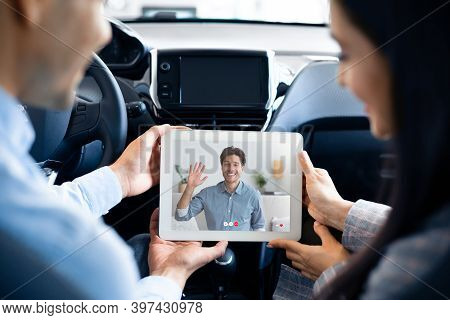 Unrecognizable Couple Having Video Call With Their Male Friend While Travelling By Car, Using Digita